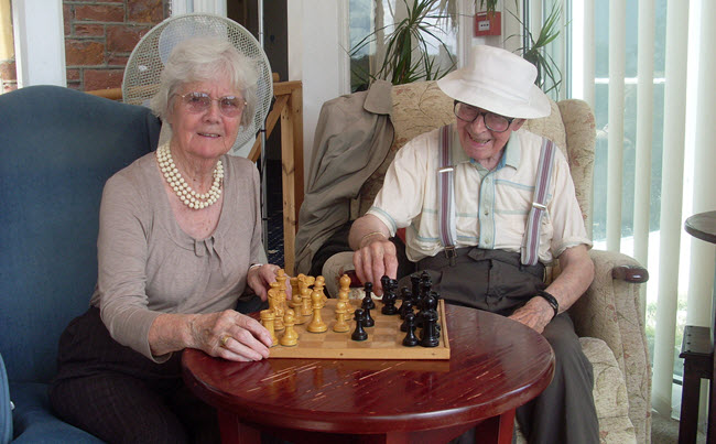 Chess in the conservatory at Moors Park Care Home